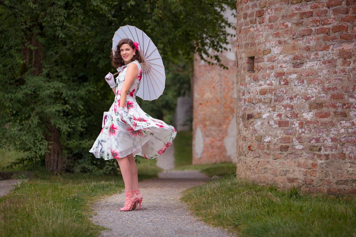 RetroCat wearing a light summer dress and matching nylons