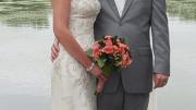 Editor Christina Koch married Bart Thoreson on Aug. 29 along the lake behind their Iowa home.