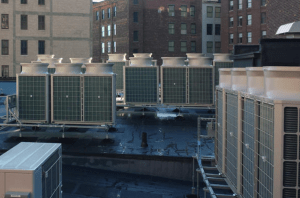 Modular steel equipment mounts support seven groupings of 20 CITY MULTI Series VRF condensers, ranging up to 325,000 Btu.