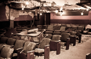 BEFORE: After serving as a silent movie house, home to various businesses and an adult movie theater, the Strand went dark.
