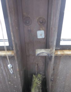 Image 3a: Fortunately, the original design drawings were available and well-crafted, clearly showing the insulated glass secured to the steel mullions with a rubber zipper gasket.