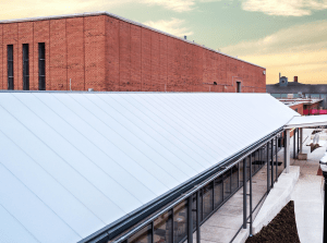 EXTECH's SKYSHADE 8000 is a long-spanning standing-seam canopy system that offers continuous battens that rigidly clamp over structural cellular polycarbonate glazing (CPG).