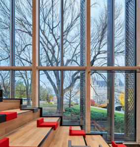 The use of wood brings in a natural material; glass and steel were used as contrasts to the original concrete.