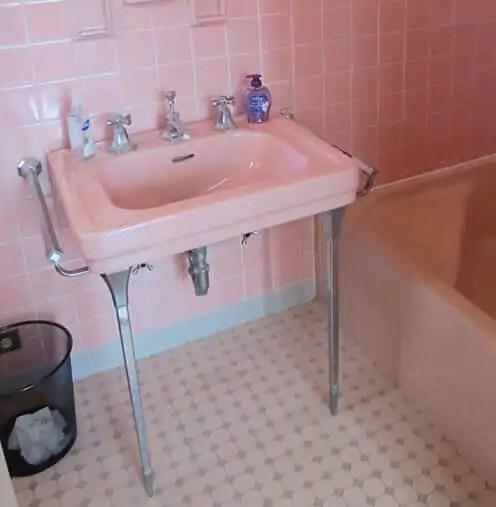 vintage bathroom sink with chrome legs