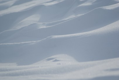ripples in snowdrifts along side the road