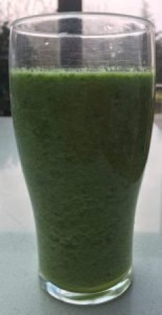 Picture of a glass of smoothie spinach pineapple apple cucumber lime