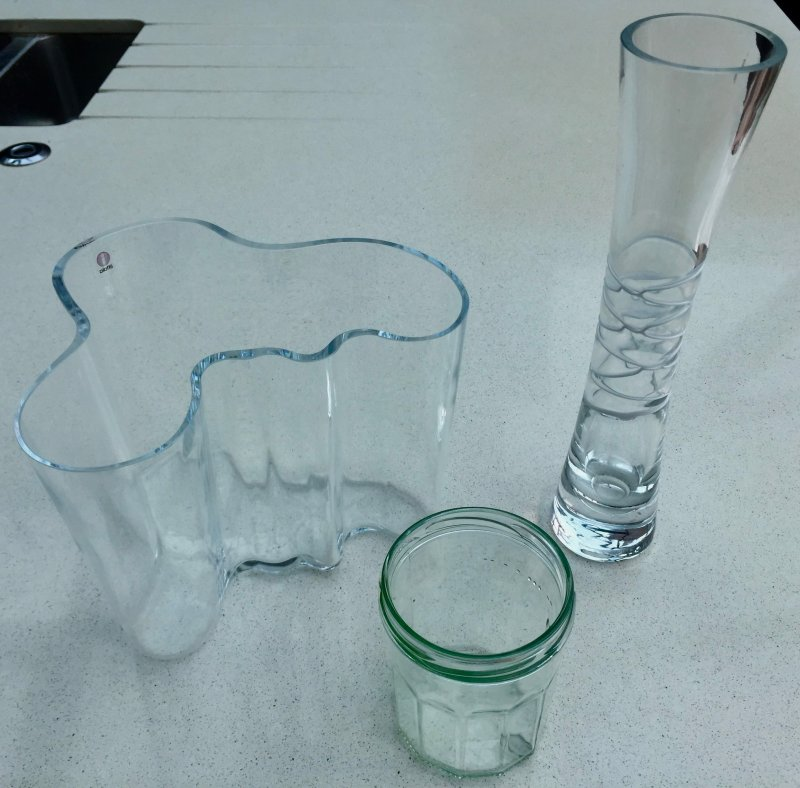 Picture of a clear glass jar and vases which can be used as your self-worth jar