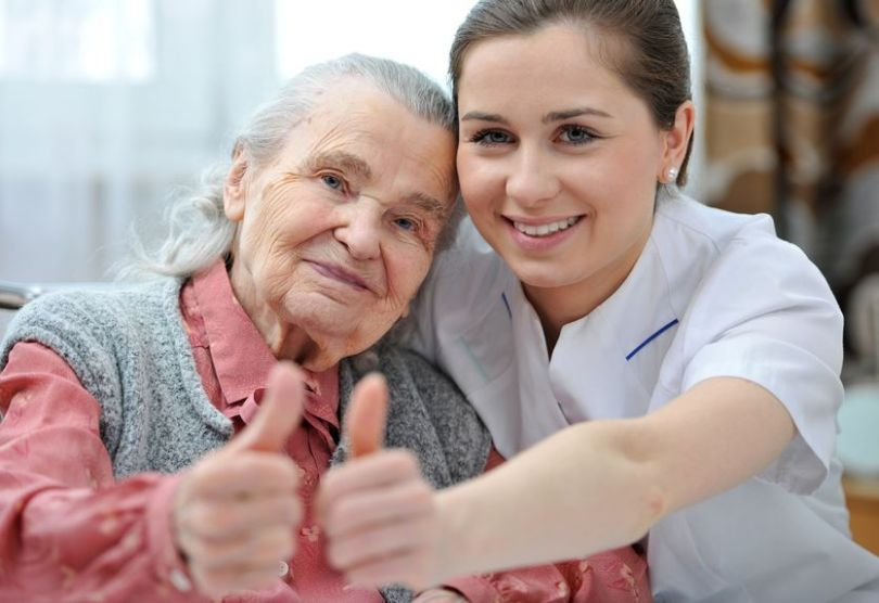 18916077 - senior woman and female nurse are showing thumbs up