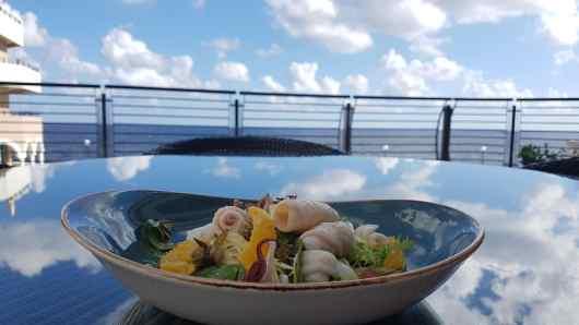 Pan-fried Calamari, citrus segments, baby spinach, and local caper berries
