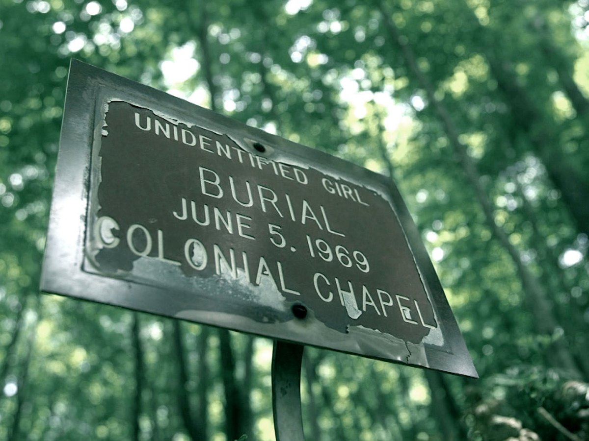 A sign marks the grave of an unknown girl known locally as Mountain Jane Doe.