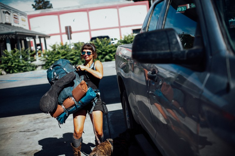 Emily Rothman of Florida throws her pack into a truck that will take her to a friend's pot farm in Garberville, Calif. She said all the women she knows have been warned of things to watch out for when coming to the area for work.