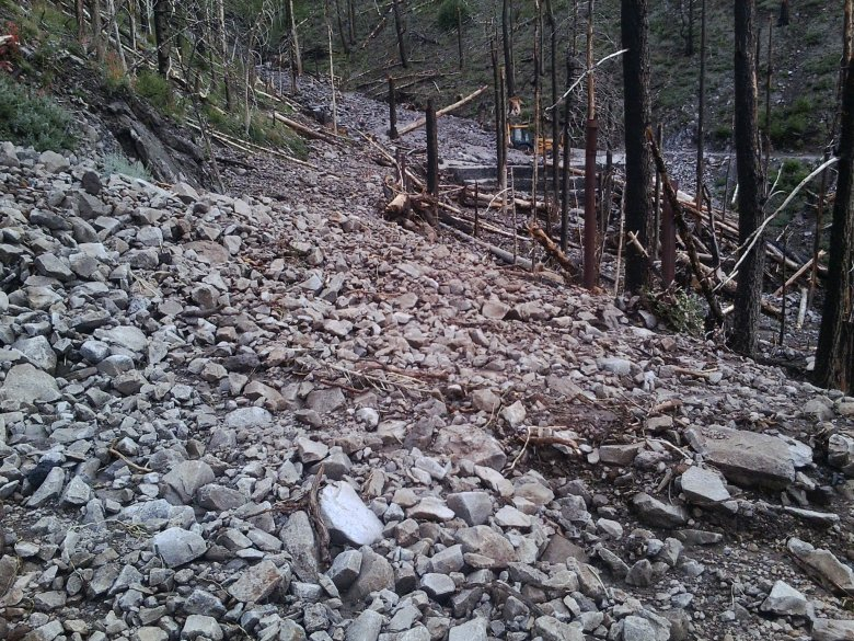 A popular trail in Coconino National Forest, near Flagstaff, Arizona, is damaged by flooding in 2013, three years after the Schultz Fire cleared the area of vegetation that would have stemmed the tide.