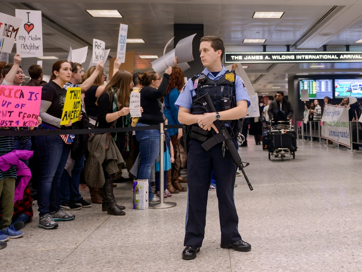 Protesters gather at the international arrivals area of the Washington Dulles International Airport to greet passengers after U.S. President Donald Trump signed an executive order which barred citizens from Iran, Iraq, Libya, Somalia, Sudan, Syria, and Yemen from entering the U.S. for the next 90 days.