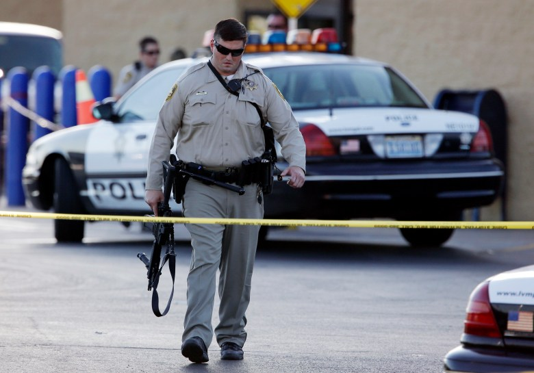 A police officer walks away from the scene of Jerad and Amanda Miller's shooting at a Las Vegas Walmart in June 2014. The couple, who had just gunned down two officers in a nearby pizzeria, were killed in a shootout with police.