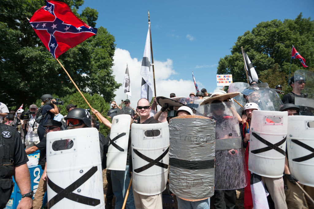 "DOWNTOWN, CHARLOTTESVILLE, VIRGINIA, UNITED STATES - 2017/08/12: Neo-Nazis, white supremacists and other alt-right factions scuffled with counter-demonstrators near Emancipation Park (Formerly ""Lee Park"") in downtown Charlottesville, Virginia. After fighting between factions escalated, Virginia State Police ordered the evacuation by all parties and cancellation of the ""Unite The Right"" rally scheduled to take place in the park."