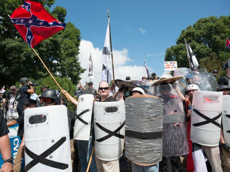 """DOWNTOWN, CHARLOTTESVILLE, VIRGINIA, UNITED STATES - 2017/08/12: Neo-Nazis, white supremacists and other alt-right factions scuffled with counter-demonstrators near Emancipation Park (Formerly """"Lee Park"""") in downtown Charlottesville, Virginia. After fighting between factions escalated, Virginia State Police ordered the evacuation by all parties and cancellation of the """"Unite The Right"""" rally scheduled to take place in the park."""