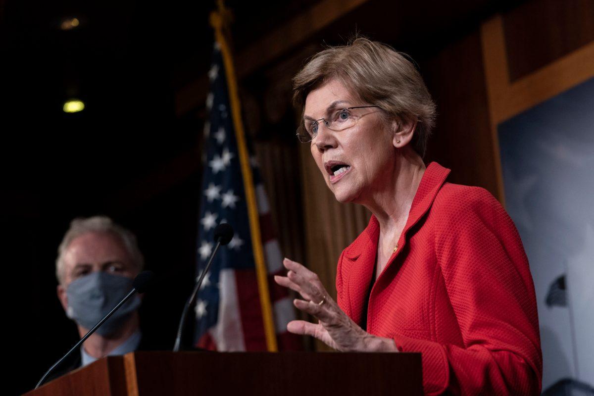 Sen. Elizabeth Warren speaks from behind a lectern.