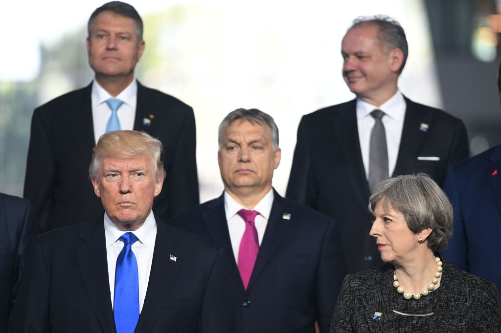 A group of world leaders posing for a photo at a NATO conference.