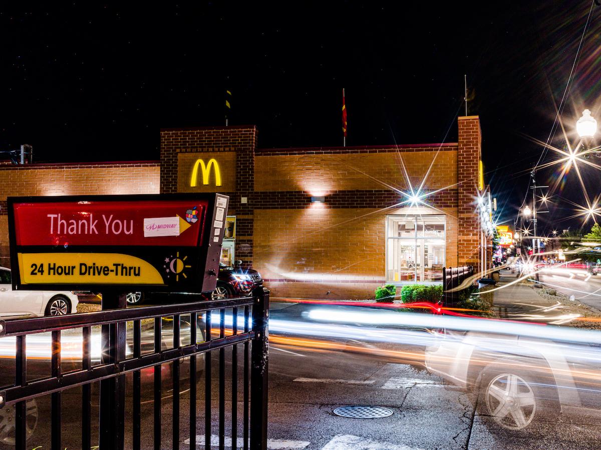 A brick McDonald's restaurant at night.