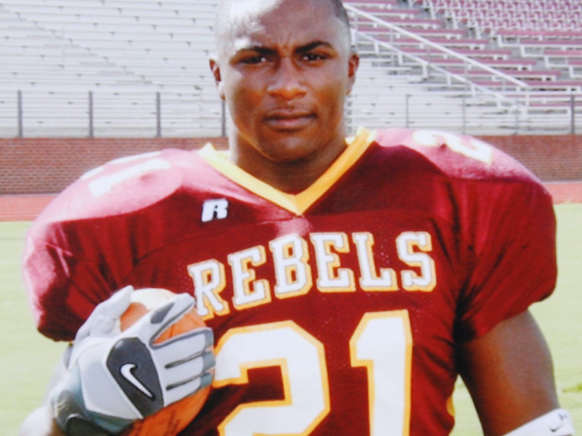 Billey Joe Johnson wearing the red and gold uniform of his high school football team, the Rebels