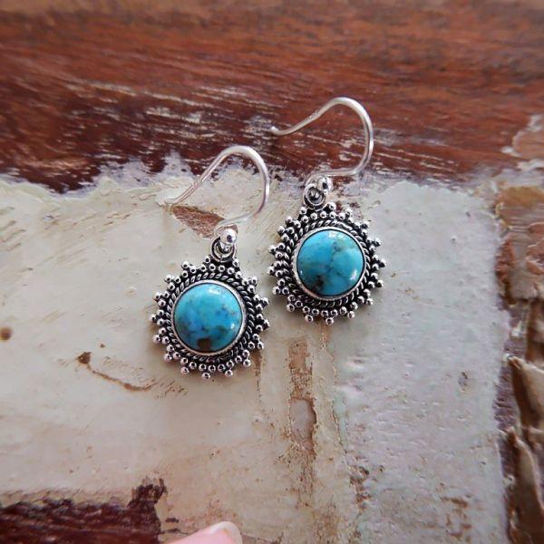 Zilveren oorbellen met Mohave Turkoois