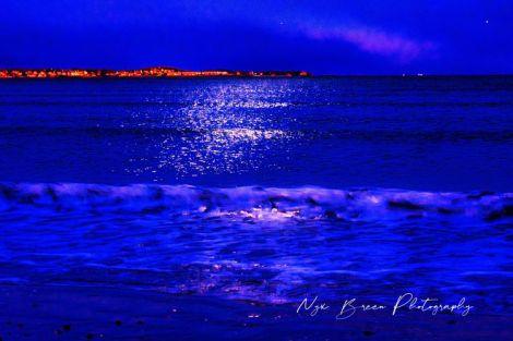 Blue-hued ocean waves
