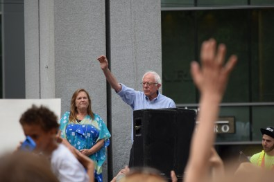 Sanders waves to the crowd while be denied the chance to talk