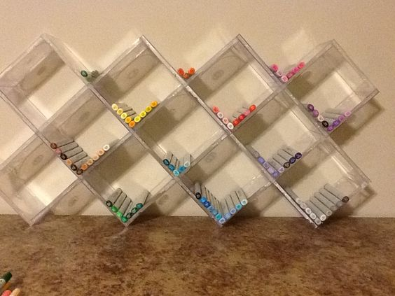 by making boxes from old cd cases you can assemble a storage unit to suit your needs