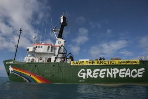 "Greenpeace's Arctic Sunrise and crew are confronting the seismic vessel in the Barents Sea north of Russia, protesting the Russian oil giant Rosneft as it prepares to drill for oil in the fragile Arctic. A banner reads ""Save the Arctic."" Early this morning, as the Rosneft-contracted vessel Akademic Lazarev began firing underwater sound cannons up to 250 decibels in the Fedynskiy license block, Greenpeace approached the vessel, demanding that it stop operations immediately. Rosneft has recently signed joint deals to drill in the Arctic with international oil companies including ExxonMobil, BP and Statoil."