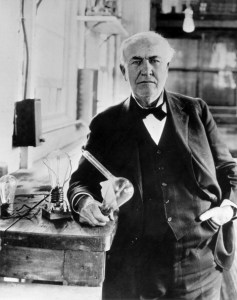 American inventor Thomas Alva Edison holding a light bulb in his laboratory. Menlo Park, 1910s (Photo by Mondadori Portfolio via Getty Images)