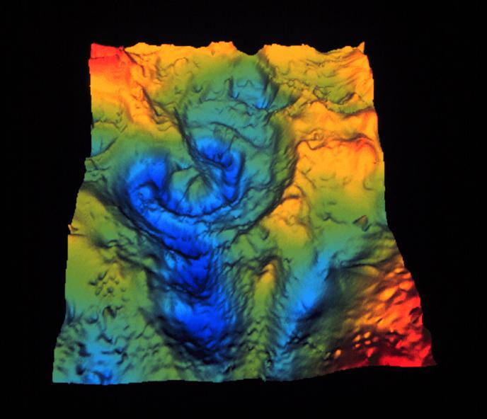 Carte générée par ordinateur à partir des mesures de la gravit de la région du cratère de Chicxulub sur la péninsule du Yucatan au Mexique.  C'est un bassin à plusieurs noyaux avec une bague extérieure d'environ 300 kilomètres de diamètre. (Crédit Image: Virgil L. Sharpton, Université de l'Alaska, Fairbanks)