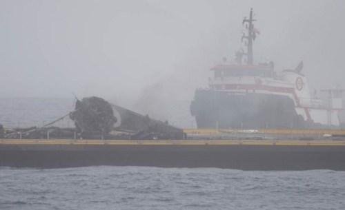 Les débris de la fusée Falcon 9 après la tentative d'atterrissage de dimanche. (Crédit: SpaceX)
