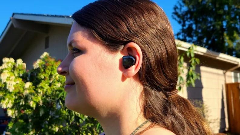 Master & Dynamic MW08 earbud listening