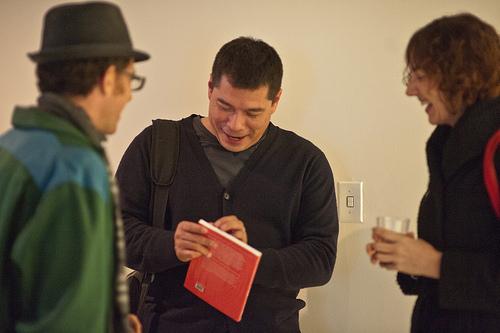 Curator Eduardo Navas at gallery opening