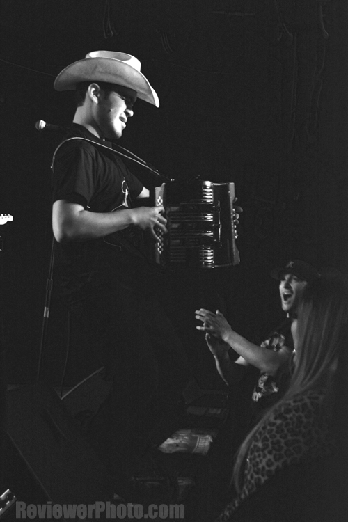 Alvaro, lead accordionist from the San Antonio, TX, conjunto punk rock-y-roll band Pinata Protest, playing at Brick By Brick in San Diego in 2014. Photo by ReviewerPhoto.com.