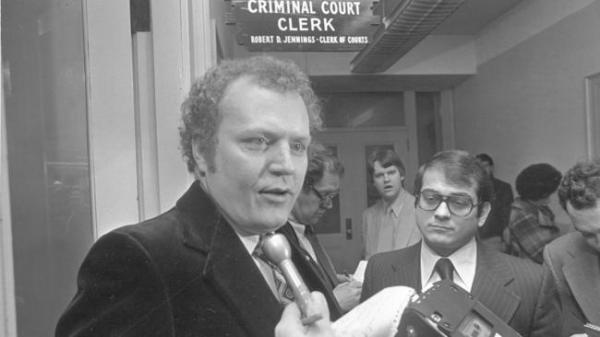 Hustler magazine Publisher Larry Flynt, left, speaks to reporters with attorney Paul Cambria at his side on Feb. 17, 1978, in Cincinnati. Cambria, who is still Flynt's general counsel, says pornography cases have never made up more than 1 percent of his caseload. (AP, the chicagotribune.com)