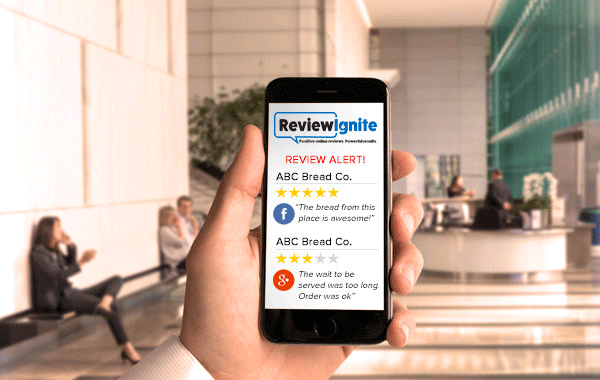 Image showing a close-up of a mobile phone with online review alerts on screen.