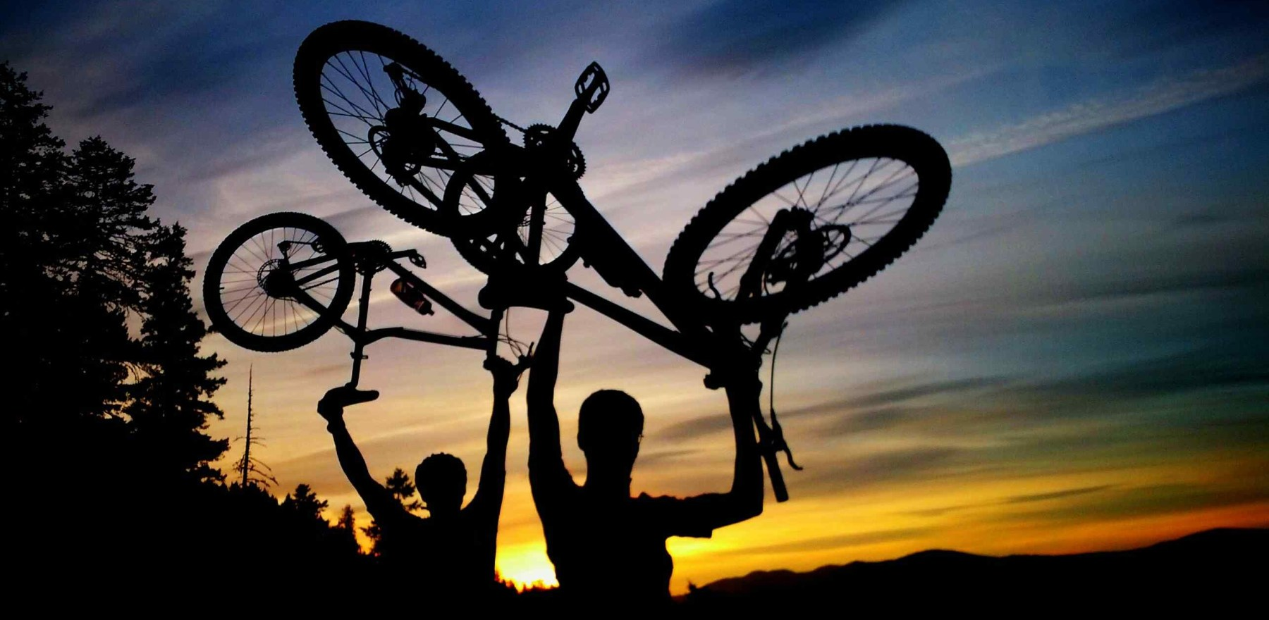 Mountain Bike, two guys, sunset