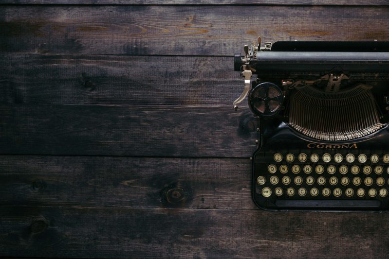 Typewriter on wooden desk used to signify making contact