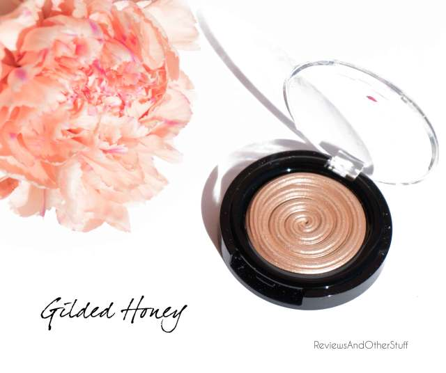 laura geller baked gelato swirl illuminator in gilded honey review