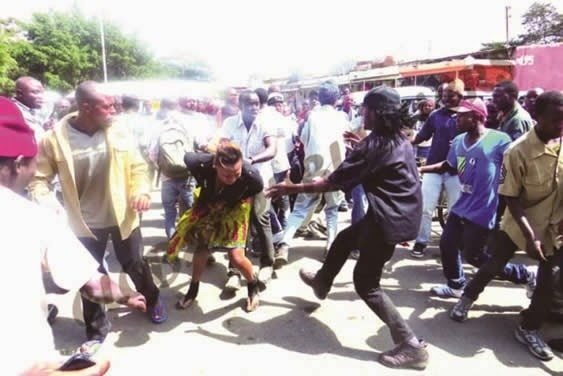 Touts are a constant menace at bus stations. Image credit ireporterstv.co