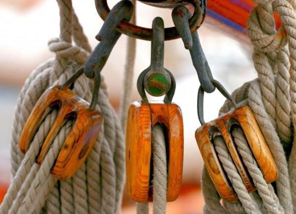 Wooden pulleys. Image credit wisegeek.com