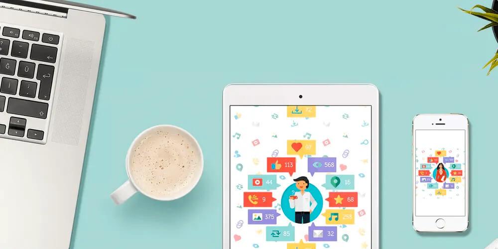 Revista Digital On-line: Note book, xícara de café, tablet e um smartphone sobre a mesa