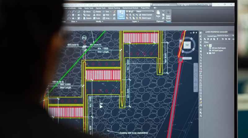 female engineer planning dam