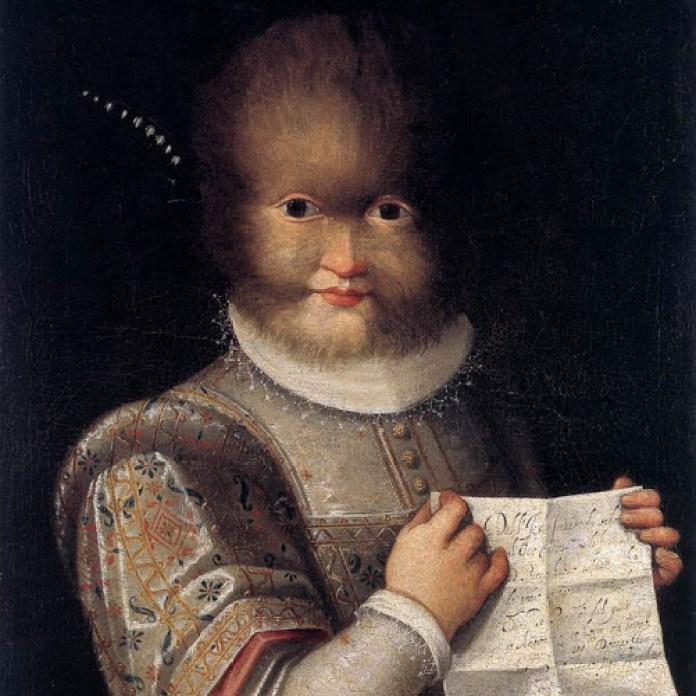 """Antonietta Gonsalvus, a filha mais nova de Catarina e Petrus, aqui retratada por Lavinia Fontana (circa 1583), segurando um bilhete que descreve as suas origens e a sua condição actual enquanto """"propriedade"""" da marquesa de Soragna."""
