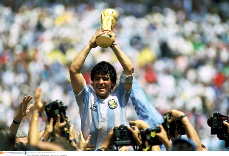 Football - 1986 World Cup - Final - Argentina v West Germany - Azteca Stadium - 29/6/86 Argentina's Diego Maradona lifts the World Cup trophy Mandatory Credit: Action Images / Sporting Pictures / Tony Marshall CONTRACT CLIENTS PLEASE NOTE: ADDITIONAL FEES MAY APPLY - PLEASE CONTACT YOUR ACCOUNT MANAGER