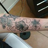 Black and grey floral tattoo done today by Dana.   #rev...