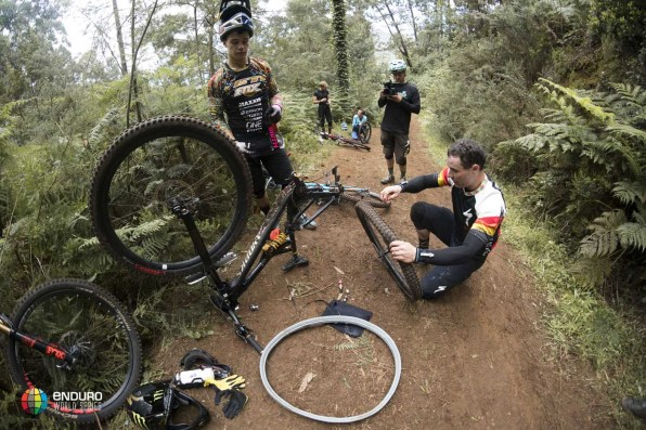 Stage 3 wreaked havoc on the riders with many suffering punctures. Graves, Lapeyrie and Clementz work away on their bikes.