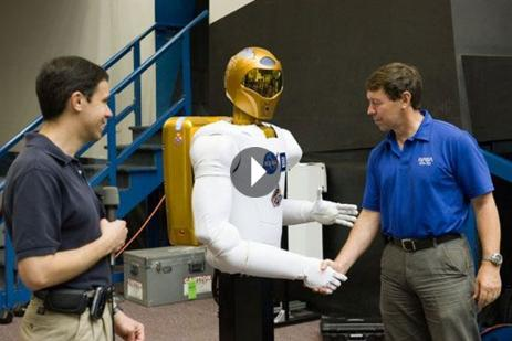 First Space Robot Handshake Historical Video