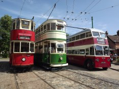 two trams and a trolley bus